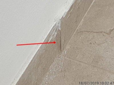 בדיקת ריצוף - אריח בולט בקיר